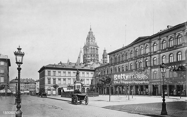Gutenbergplatz in Mainz Germany with the RomanCatholic Cathedral of St Martin in the background circa 1890