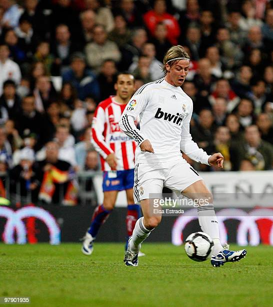 Guti of Real Madrid gives a pass during the La Liga match between Real Madrid and Sporting Gijon at Estadio Santiago Bernabeu on March 20 2010 in...