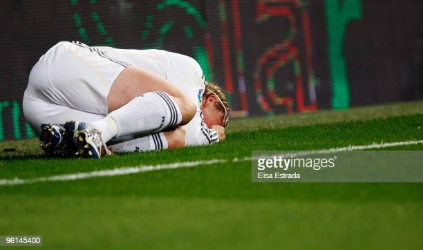 Guti of Real Madrid lies injured during the la Liga match between Real Madrid and Malaga at Estadio Santiago Bernabeu on January 24 2010 in Madrid...