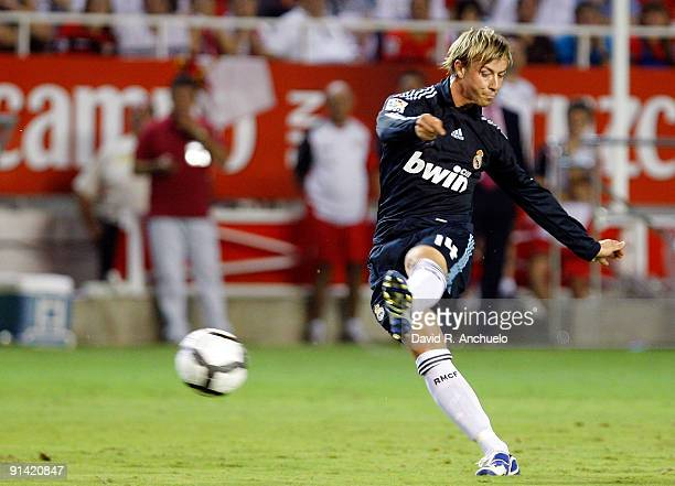 Guti of Real Madrid shoots on goal during the La Liga match between Sevilla and Real Madrid at Estadio Ramon Sanchez Pizjuan on October 4 2009 in...