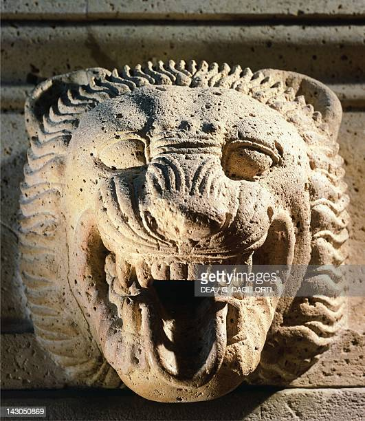 Guttering in limestone with lion heads unearthed near the Temple of Victory at the site of Himera Sicily Italy Detail of a lion's head Ancient Greek...