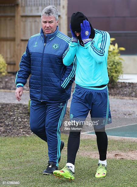 Guus Hiddink manager of Chelsea in discussion with Kenedy during a Chelsea training session ahead of their UEFA Champions League round of 16 second...