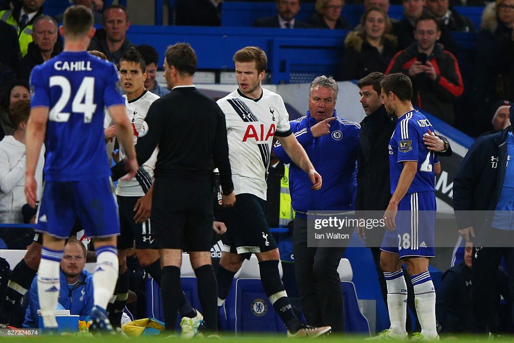 Guus Hiddink the interim manager of Chelsea and Mauricio Pochettino the manager of Tottenham Hotspur acts as peace makers after one of numerous scuffles breaks out during the Barclays Premier League match between Chelsea and Tottenham Hotspur at Stamford Bridge on May 02, 2016 in London, England.
