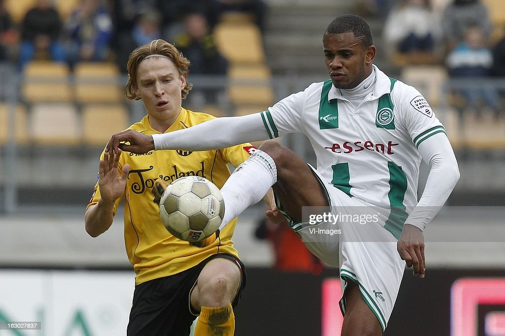 Guus Hupperts of Roda JC (L), Leandro Bacuna of FC Groningen (R) during the Dutch Eredivisie match between Roda JC Kerkrade and FC Groningen at the Parkstad Limburg Stadium on march 03, 2013 in Kerkrade, The Netherlands