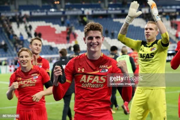 *Guus Til* of AZ Alkmaar celebrate the victory with *Jonas Svensson* of AZ Alkmaar *Marco Bizot* of AZ Alkmaar during the Dutch Eredivisie match...