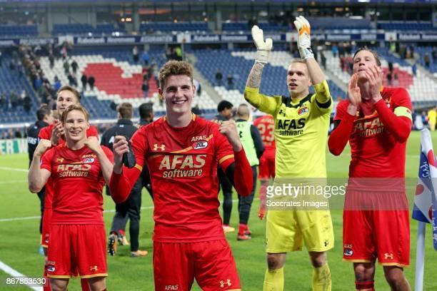 *Guus Til* of AZ Alkmaar celebrate the victory with *Wout Weghorst* of AZ Alkmaar *Marco Bizot* of AZ Alkmaar *Jonas Svensson* of AZ Alkmaar during...