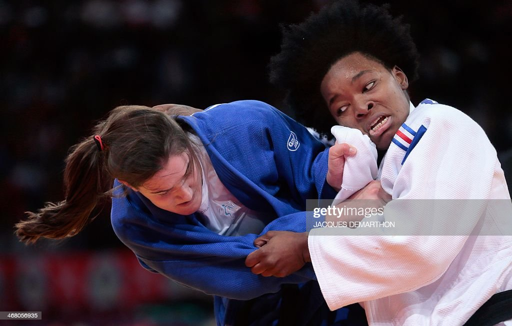 Guusje Steenhuis of the Netherlands competes with France's Audrey Tcheumeo during the women's 78kg quarterfinals at the 2014 Paris Judo Grand Slam...