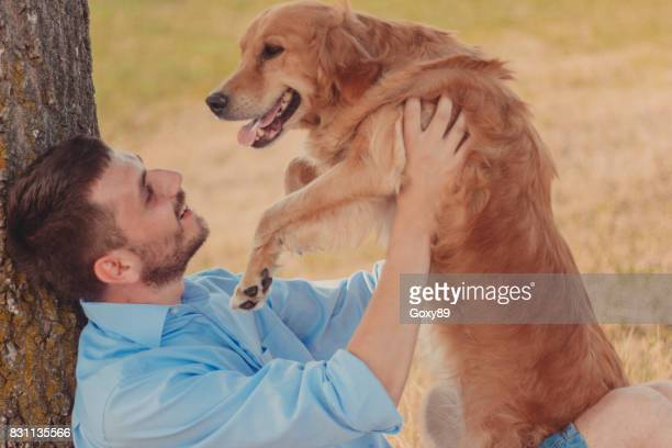 Guy and his dog, golden retriever
