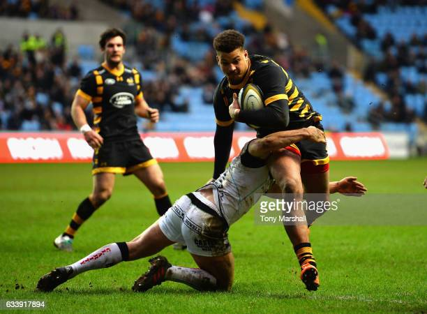 Guy Armitage of Wasps is tackled by Joe Thomas of Ospreys as he runs in to score a try during the AngloWelsh Cup match between Wasps and Ospreys at...