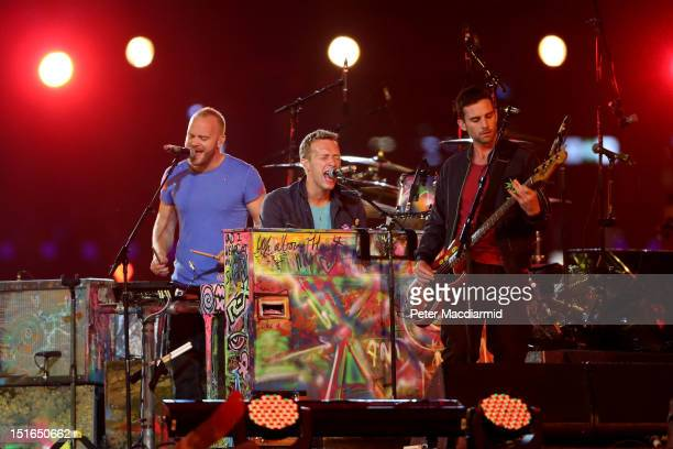 Guy Berryman Chris Martin and Jonny Buckland of Coldplay perform during the closing ceremony on day 11 of the London 2012 Paralympic Games at Olympic...