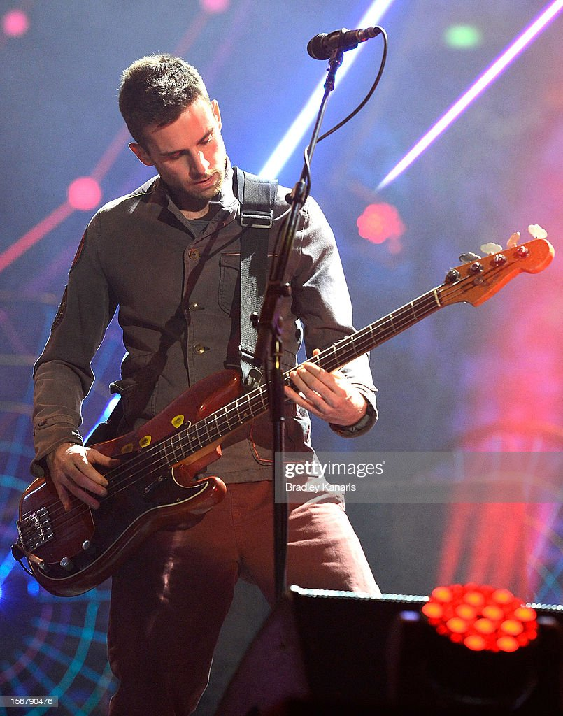 Guy Berryman of Coldplay performs live for fans at Suncorp Stadium on November 21, 2012 in Brisbane, Australia.