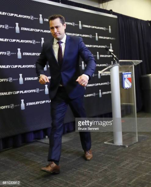 Guy Boucher of the Ottawa Senators leaves the podium after speaking with the media prior to playing against the New York Rangers in Game Six of the...