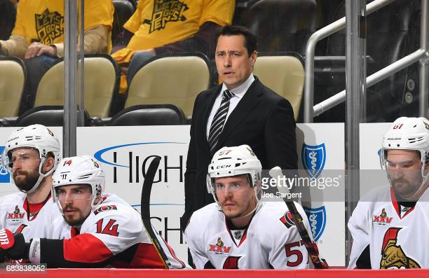 Guy Boucher of the Ottawa Senators looks on against the Pittsburgh Penguins in Game One of the Eastern Conference Final during the 2017 NHL Stanley...