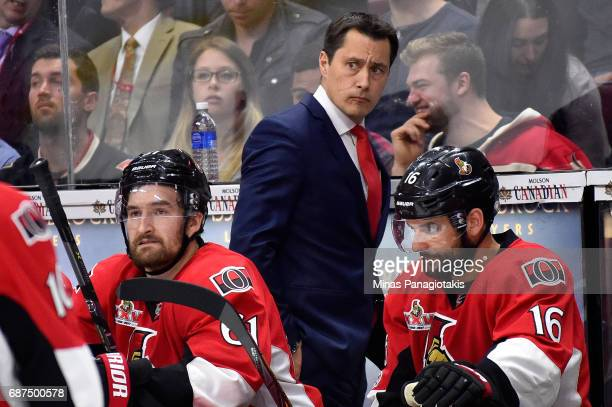 Guy Boucher of the Ottawa Senators looks on against the Pittsburgh Penguins during the second period in Game Six of the Eastern Conference Final...