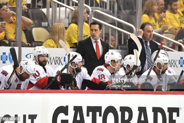 Guy Boucher of the Ottawa Senators looks on against the Pittsburgh Penguins during the second period in Game Seven of the Eastern Conference Final...