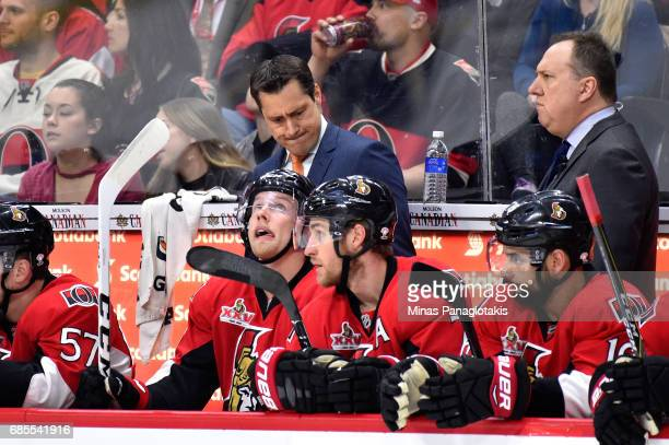 Guy Boucher of the Ottawa Senators reacts against the Pittsburgh Penguins during the first period in Game Four of the Eastern Conference Final during...
