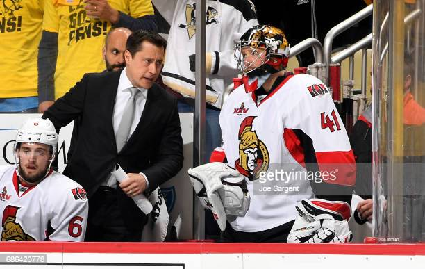 Guy Boucher of the Ottawa Senators talks to Craig Anderson of the Ottawa Senators after being pulled in the first period against the Pittsburgh...