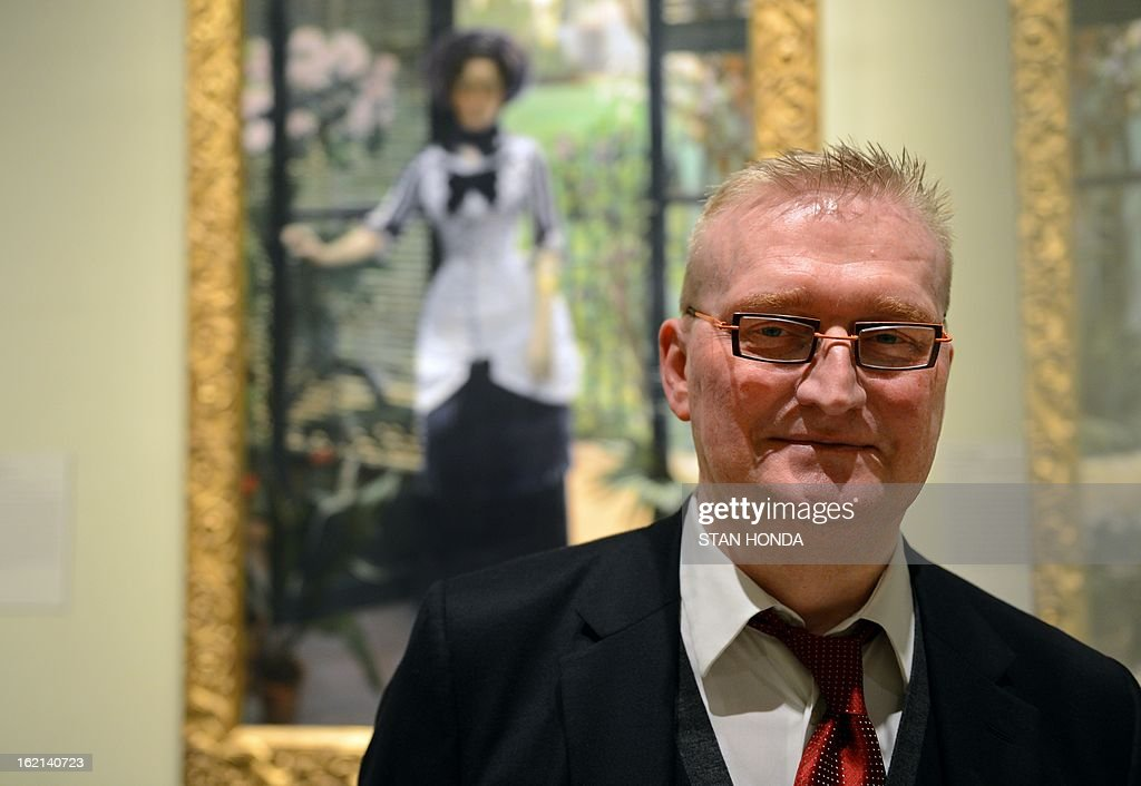 Guy Cogeval, President of Musee d'Orsay and Musee de l'Orangerie poses with 'In the Conservatory (Madame Bartholome), ca 1881' by Albert Bartholome (L) on loan from the Musee d'Orsay, in the exhibition 'Impressionism, Fashion, and Modernity' February 19, 2013 at The Metropolitan Museum of Art in New York. The look at the role of fashion in the works of the Impressionists and their contemporaries shows 80 major paintings with period costumes, accessories, fashion plates, photographs, and popular prints. AFP PHOTO/Stan HONDA