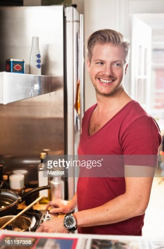 Guy cooking in kitchen : Stock Photo
