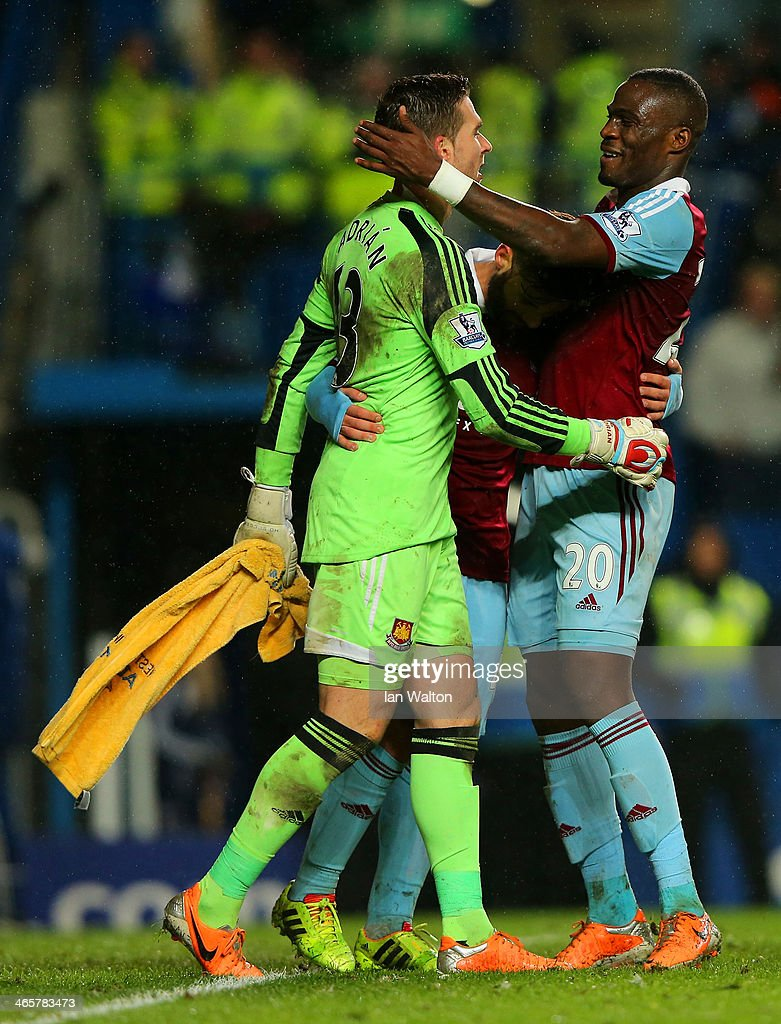 <a gi-track='captionPersonalityLinkClicked' href=/galleries/search?phrase=Guy+Demel&family=editorial&specificpeople=575843 ng-click='$event.stopPropagation()'>Guy Demel</a> and Adrian of West Ham hug at the final whistle during the Barclays Premier League match between Chelsea and West Ham United at Stamford Bridge on January 29, 2014 in London, England.