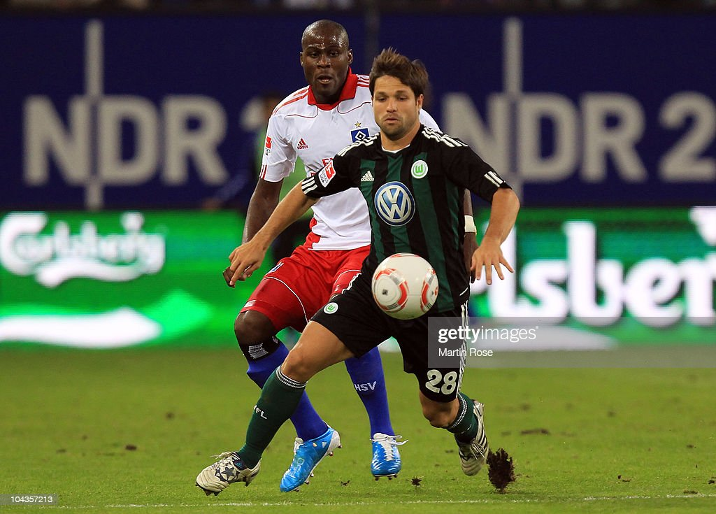 Guy Demel (back) of Hamburg and Diego (front) of Wolfsburg battle for the ball during the Bundesliga match between Hamburger SV and VFL Wolfsburg at Imtech Arena on September 22, 2010 in Hamburg, Germany.