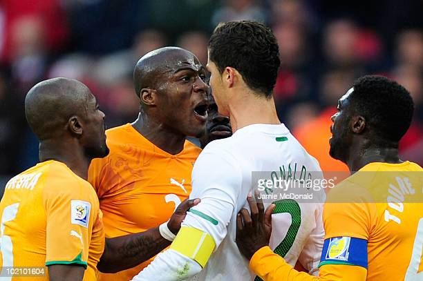 Guy Demel of Ivory Coast argues with Cristiano Ronaldo during the 2010 FIFA World Cup South Africa Group G match between Ivory Coast and Portugal at...