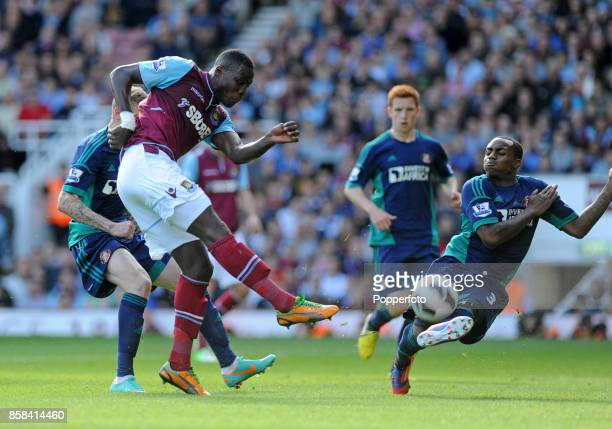 Guy Demel of West Ham has his shot blocked by Danny Rose of Sunderland during the Barclays Premier League match between West Ham United and...