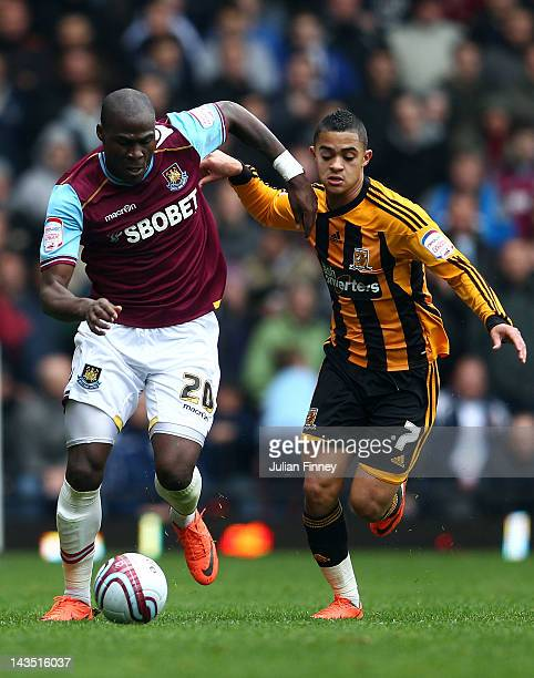 Guy Demel of West Ham holds off Cameron Stewart of Hull City during the npower Championship match between West Ham United and Hull City at Boleyn...