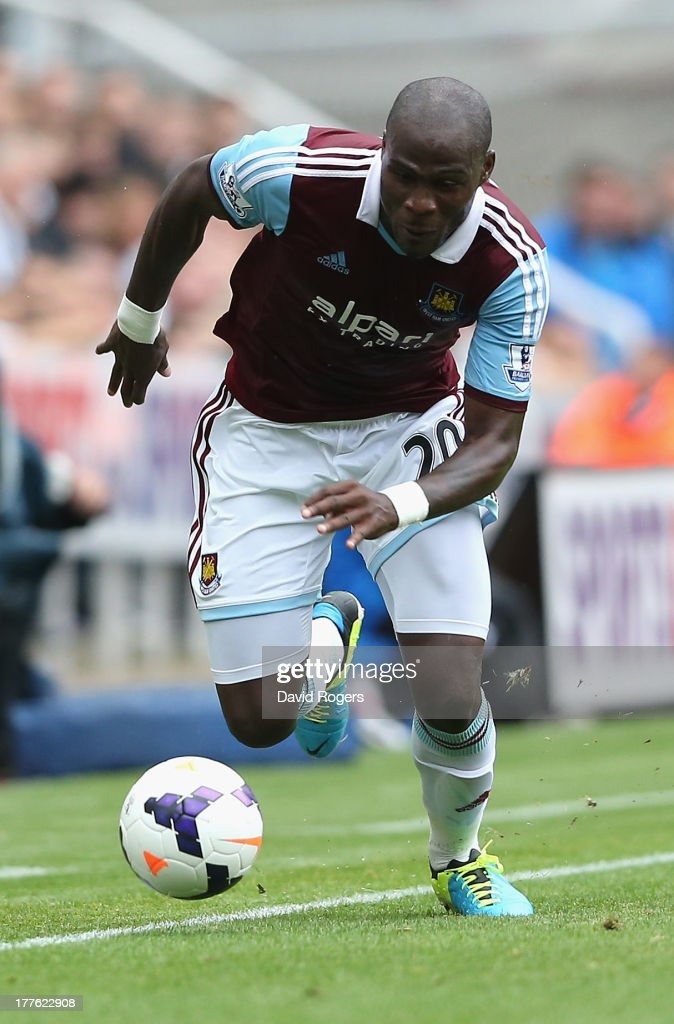 Guy Demel of West Ham runs with the ball during the Barclays Premier League match between Newcastle United and West Ham United at St James' Park on August 24, 2013 in Newcastle upon Tyne, England.