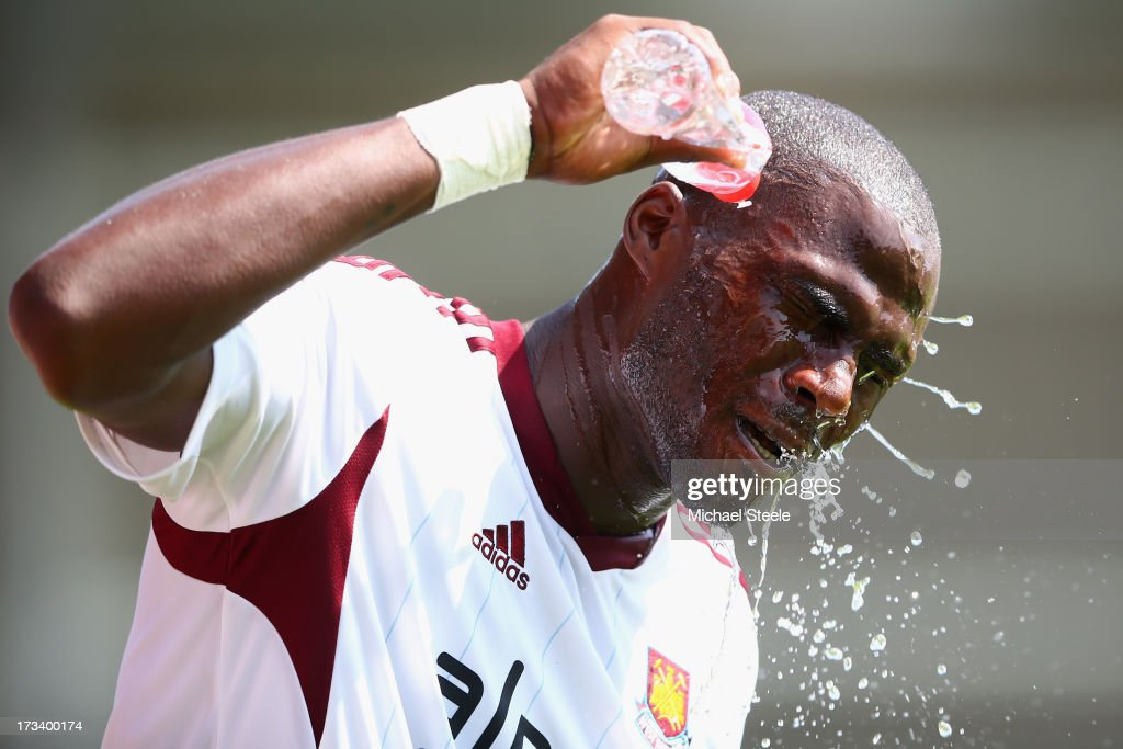 <a gi-track='captionPersonalityLinkClicked' href=/galleries/search?phrase=Guy+Demel&family=editorial&specificpeople=575843 ng-click='$event.stopPropagation()'>Guy Demel</a> of West Ham United cools off during the Pre Season Friendly match between Bournemouth and West Ham United at Goldsands Stadium on July 13, 2013 in Bournemouth, England.