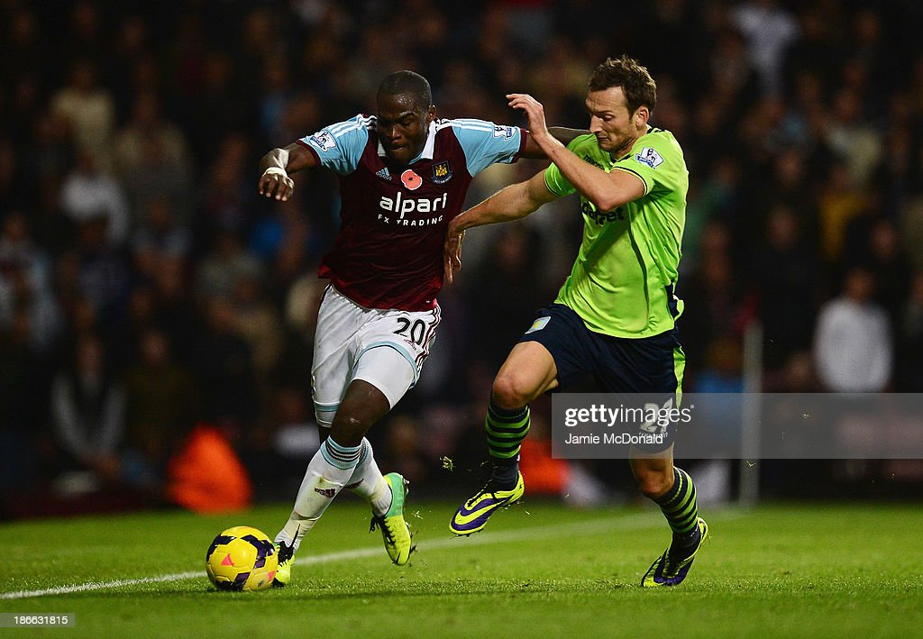 <a gi-track='captionPersonalityLinkClicked' href=/galleries/search?phrase=Guy+Demel&family=editorial&specificpeople=575843 ng-click='$event.stopPropagation()'>Guy Demel</a> of West Ham United is challenged by Libor Kozak of Aston Villa during the Barclays Premier League match between West Ham United and Aston Villa at the Boleyn Ground on November 2, 2013 in London, England.
