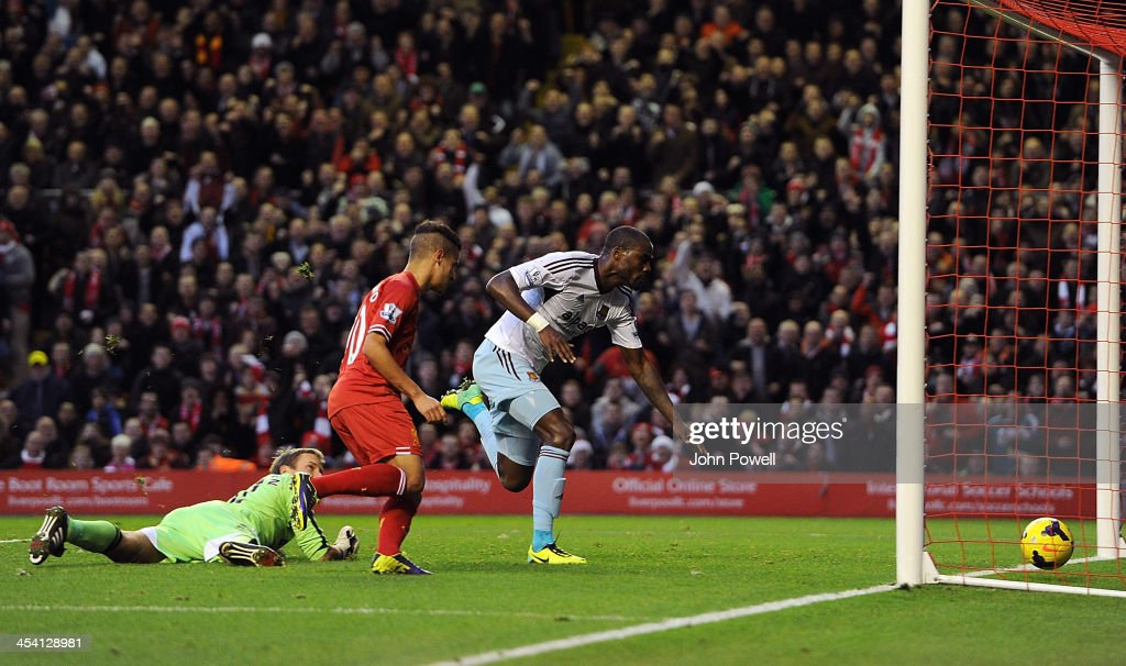 Guy Demel of West Ham United scores an own goal during the Barclays Premier League match between Liverpool and West Ham United at Anfield on December 7, 2013 in Liverpool, England.