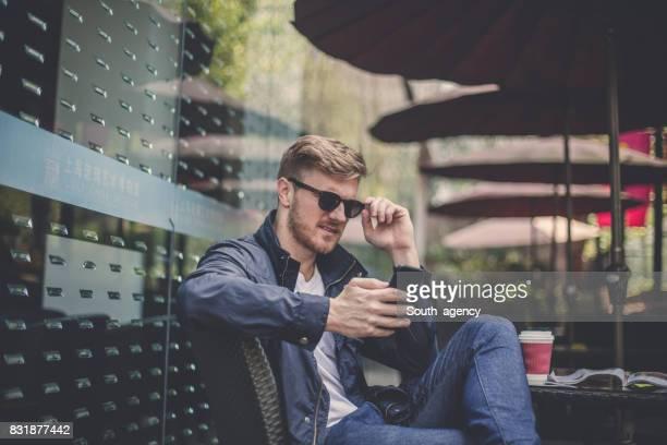 Guy enjoying in cafe