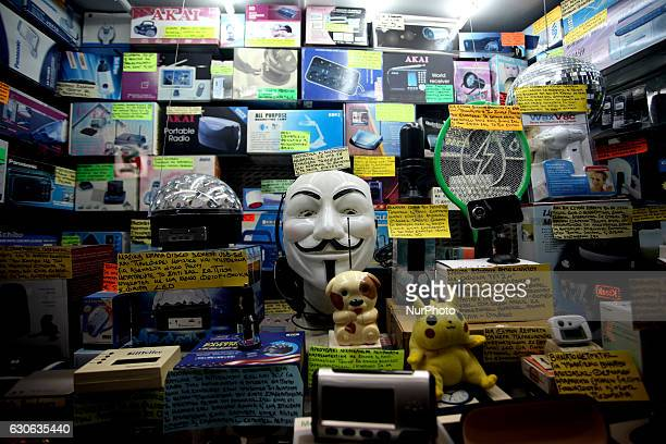A Guy Fawkes mask among other items in a shop window in Athens Greece December 28 2016