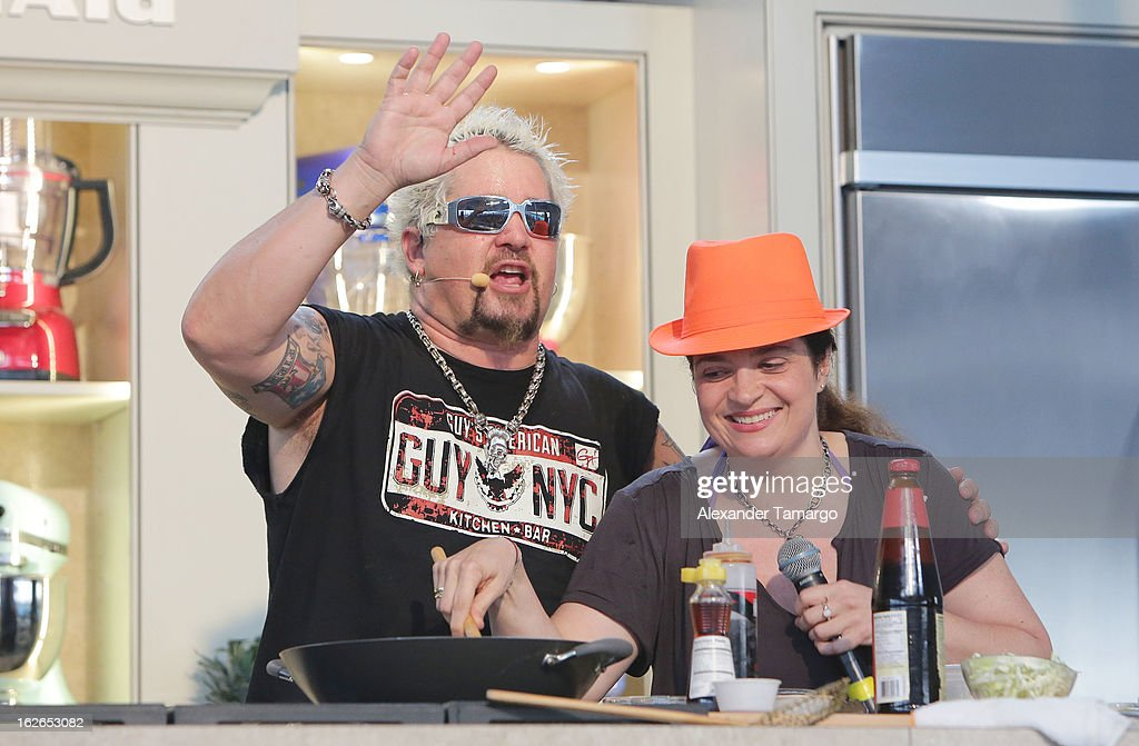 Guy Fieri and Alexandra Guarnaschelli attend South Beach Wine and Food Festival 2013 Grand Tasting Village on February 24, 2013 in Miami Beach, Florida.
