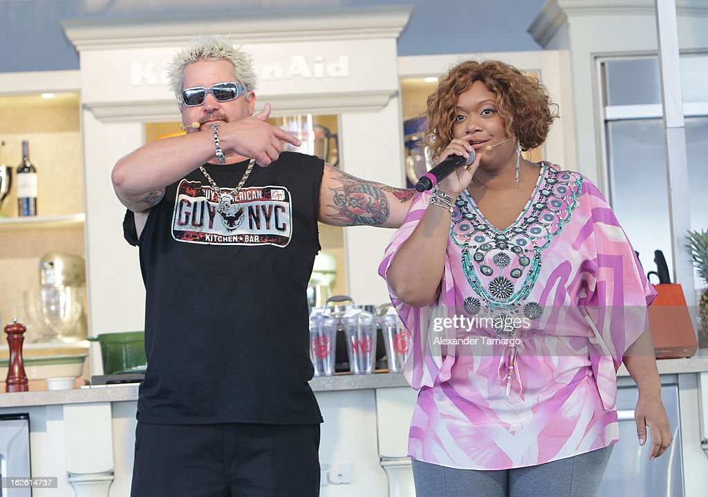 Guy Fieri and Sunny Anderson attend South Beach Wine and Food Festival 2013 Grand Tasting Village on February 24, 2013 in Miami Beach, Florida.