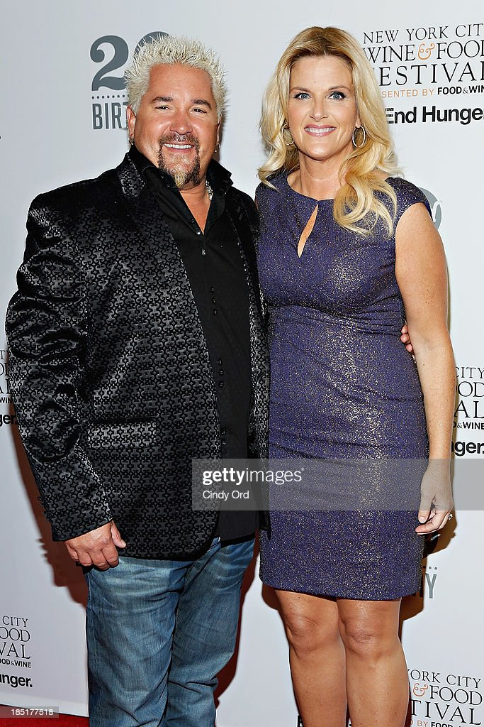 <a gi-track='captionPersonalityLinkClicked' href=/galleries/search?phrase=Guy+Fieri&family=editorial&specificpeople=4593795 ng-click='$event.stopPropagation()'>Guy Fieri</a> and <a gi-track='captionPersonalityLinkClicked' href=/galleries/search?phrase=Trisha+Yearwood&family=editorial&specificpeople=216434 ng-click='$event.stopPropagation()'>Trisha Yearwood</a> attend Food Networks 20th birthday celebration at Pier 92 on October 17, 2013 in New York City.