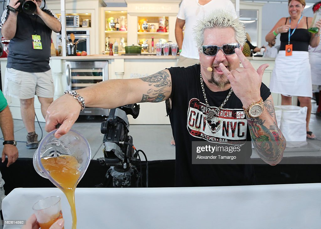 <a gi-track='captionPersonalityLinkClicked' href=/galleries/search?phrase=Guy+Fieri&family=editorial&specificpeople=4593795 ng-click='$event.stopPropagation()'>Guy Fieri</a> attends South Beach Wine and Food Festival 2013 Grand Tasting Village on February 24, 2013 in Miami Beach, Florida.
