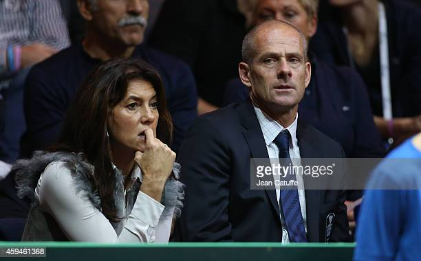 Guy Forget and his wife Isabelle Forget attend day three of the Davis Cup tennis final between France and Switzerland at the Grand Stade Pierre...