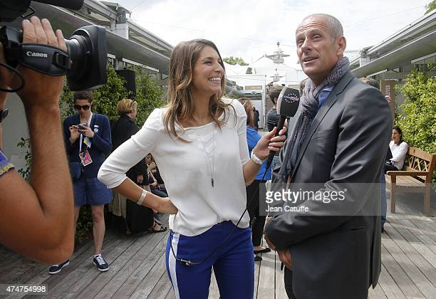 Guy Forget is interviewed by Laury Thilleman for Eurosport during day 2 of the French Open 2015 at Roland Garros stadium on May 25 2015 in Paris...