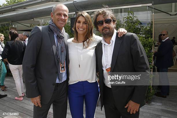 Guy Forget Laury Thilleman and Henri Leconte attend day 2 of the French Open 2015 at Roland Garros stadium on May 25 2015 in Paris France