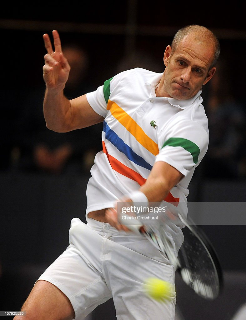 Guy Forget of France hits a forehand during the match against John McEnroe of America on Day Three of the Statoil Masters Tennis at the Royal Albert Hall on December 7, 2012 in London, England.