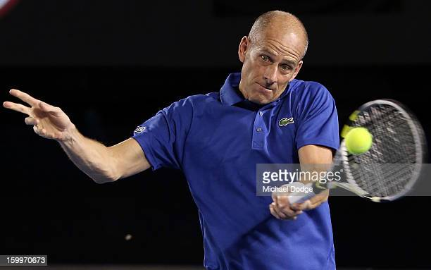 Guy Forget of France plays a forehand during his legends doubles match with Henry Leconte of France against Pat Cash of Australia and Goran...