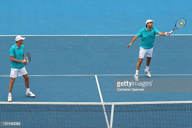 Guy Forget of France plays a forehand with Henri Leconte of France in the legends match against Darren Cahill of Australia and Richard Fromberg of...