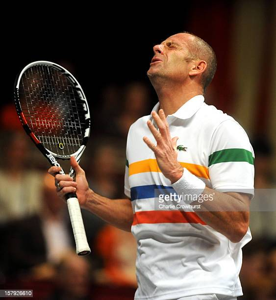 Guy Forget of France reacts after hitting a shot wide during the match against John McEnroe of America on Day Three of the Statoil Masters Tennis at...