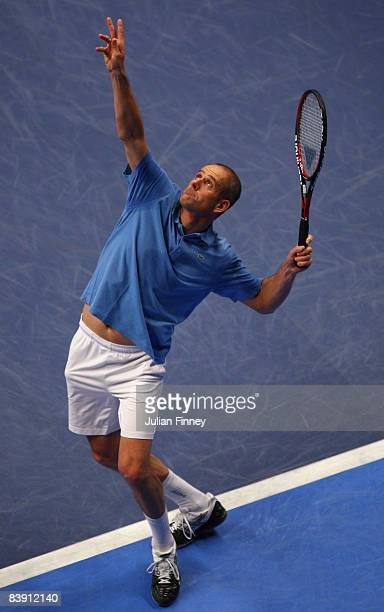 Guy Forget of France serves to Pat Cash of Australia during the BlackRock Masters Tennis at the Royal Albert Hall on December 4 2008 in London England