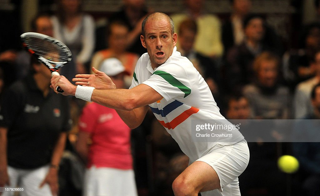 <a gi-track='captionPersonalityLinkClicked' href=/galleries/search?phrase=Guy+Forget&family=editorial&specificpeople=235573 ng-click='$event.stopPropagation()'>Guy Forget</a> of France stretches for a backhand during the match against John McEnroe of America on Day Three of the Statoil Masters Tennis at the Royal Albert Hall on December 7, 2012 in London, England.
