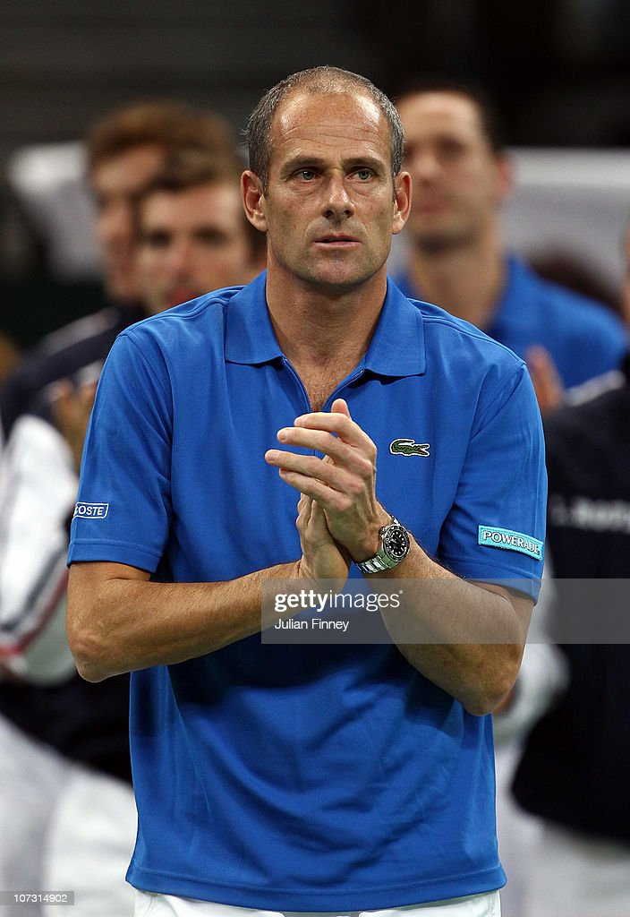 Guy Forget the french captain encourages Gilles Simon of France in his match against Novak Djokovic of Serbia during day one of the Davis Cup Tennis...