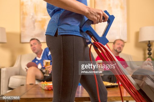 Guy get interrupted from watching sport by housework