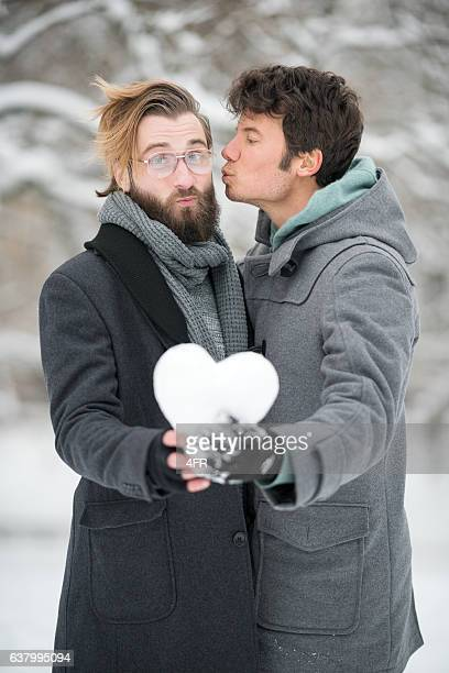 Guy giving his best Friend a Kiss, Winter Love